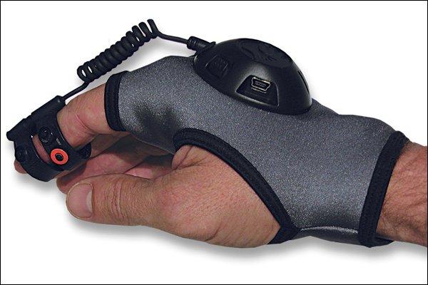 Устройство представляет собой перчатку с электронным блоком и органами управления. Для изменения положения указателя ... - Изображение 1