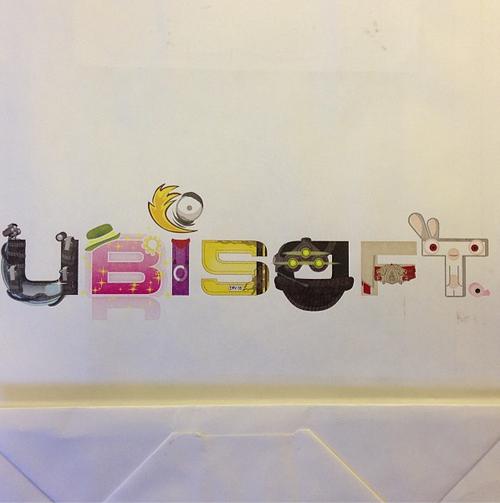 Пакет, который Ubisoft дал в Париже. Каждая буква-  франшиза Ubisoft. Отгадаете? Кстати, спецрепортаж по результатам .... - Изображение 1
